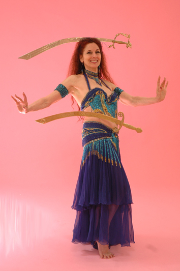 Marin County-based Dhyanis performs a double sword belly dance.