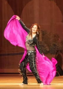 Dhyanis, a 40-year veteran of bellydance, on stage at Rakkasah West 2015.